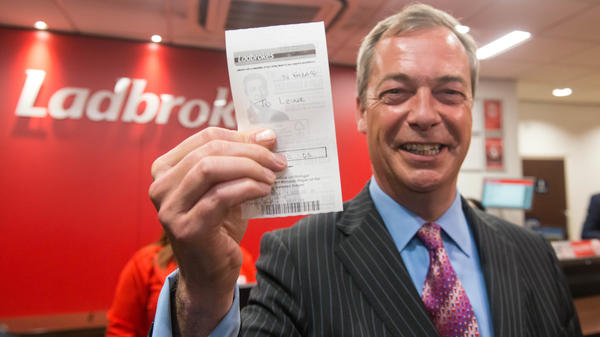 Nigel Farage, leader of the U.K. Independence Party, poses after placing a bet that Britain will vote to leave the European Union in Thursday's referendum known as the Brexit. Britain's bookmakers, who have done better than pollsters in recent British ballots, say the odds favor Britain staying in the E.U.
