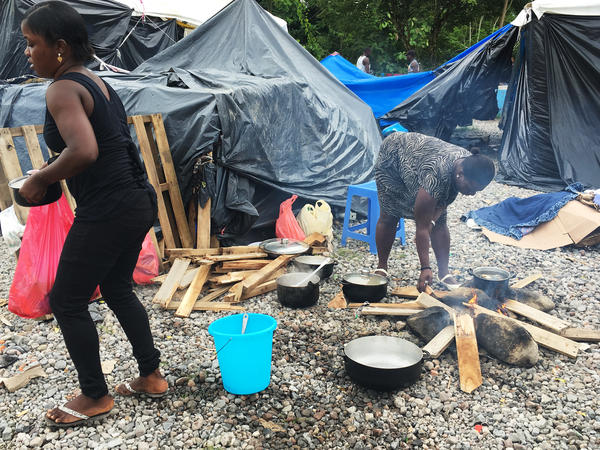 A woman builds a fire at a migrant camp on the Costa Rica-Panama border. The area has seen a recent surge of migrants coming from Africa, hoping to make it to the U.S.