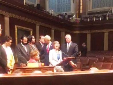 U.S. Rep. Kathy Castor (in white) joined House Democrats protesting inaction on gun legislation.