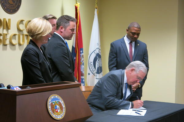 Missouri Gov. Jay Nixon visited the Jackson County Prosecutor's Office to sign legislation to protect victims of human trafficking.