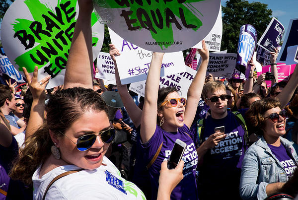 Abortion rights activists celebrate outside the U.S. Supreme Court Monday for a ruling in a case over a Texas law that places restrictions on abortion clinics.