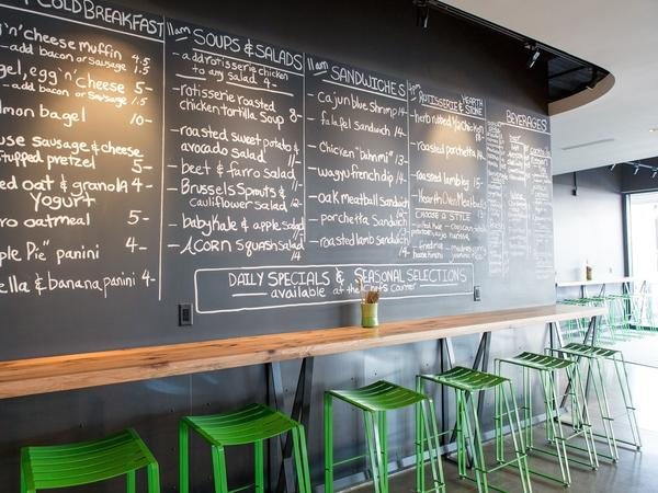 Brider, in Denver, features slate gray floors, a chalkboard menu and metal elements throughout.