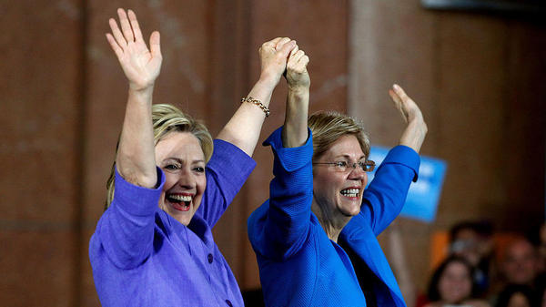 Democratic presidential candidate Hillary Clinton (left) and Sen. Elizabeth Warren wave to the crowd before a campaign rally at the Cincinnati Museum Center at Union Terminal on Monday.