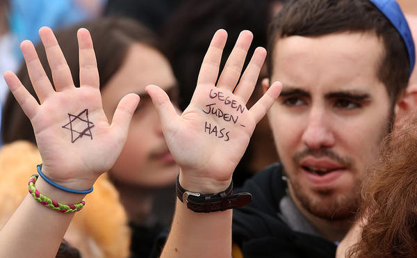 A visitor with with a Star of David and the words 'Against Hatred Toward Jews' written on her hands attends a rally against anti-Semitism on September 14, 2014 in Berlin, Germany. (Adam Berry/Getty Images)