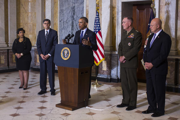 President Barack Obama (C) speaks on the Orlando shooting at the Treasury Department while Attorney General Loretta Lynch (L), Treasury Secretary Jack Lew (C-L), Chairman of the Joint Chiefs of Staff General Joseph Dunford (C-R) and Director of National Intelligence James Clapper (R) look on, on June 14, 2016 in Washington, DC. Obama directly attacked Donald Trump's proposal to ban Muslims from entering the United States. (Photo by Jim Lo Scalzo-Pool/Getty Images)