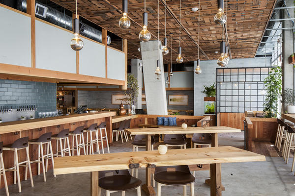 The Perennial, in San Francisco, combines industrial touches like poured floors with earthier features, like green tile behind the bar.
