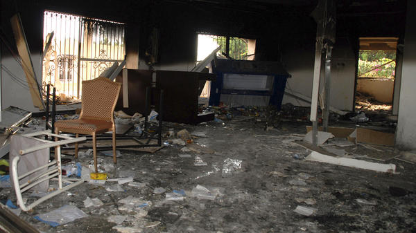 Glass, debris and overturned furniture are strewn inside a room in the gutted U.S. consulate in Benghazi, Libya, one day after it was attacked.