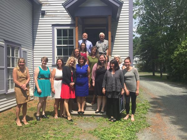 Rep. Ann Kuster, center, in blue, of New Hampshire stands outside the Lebanon headquarters of WISE, a non-profit aimed at advocacy and providing resources for sexual assault and domestic violence.
