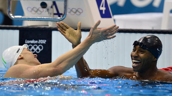 U.S. swimmer Cullen Jones (right) won the silver medal in the 50m freestyle. Here, he shakes hands with Brazil's Cesar Cielo after a semifinal heat.