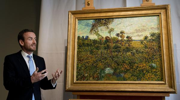 Alex Ruger, director of the Van Gogh Museum in Amsterdam, at the unveiling Monday of Vincent Van Gogh's <em>Sunset at Montmajour</em>.