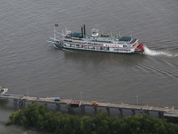 "A steamboat drifts along the Mississippi River in New Orleans. A group called America's Watershed Initiative says ""funding for infrastructure maintenance means that multiple failures may be imminent"" for the lower Mississippi River basin."