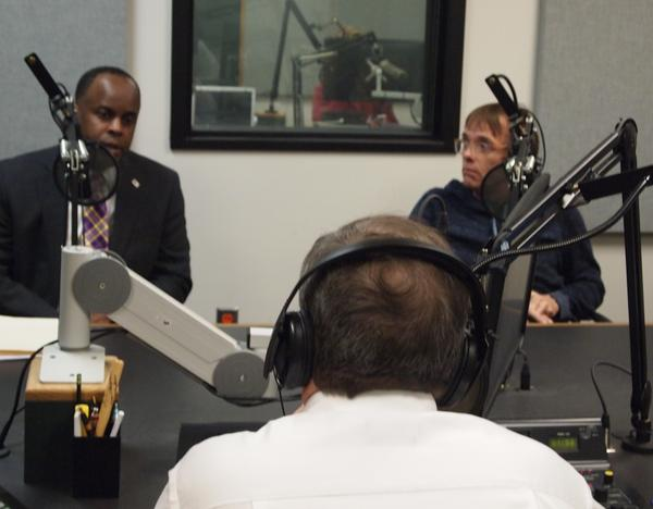 WIU President Jack Thomas (left) and UPI Chapter President Bill Thompson (right) speak with News Director Rich Egger