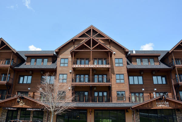 The Tram Haus Lodge at Jay Peak was one of many projects financed by EB-5 investment funds. The settlement annnounced Thursday is related to fraud accusations at Jay Peak involving the alleged misuse of millions of dollars from foreign investors.