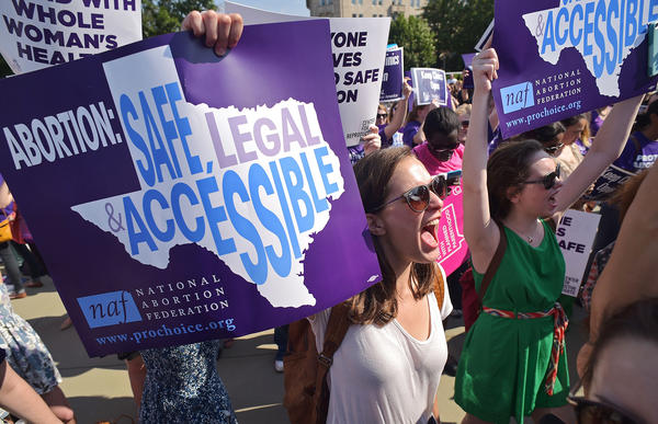 Abortion rights activists chant outside the US Supreme Court ahead of a historic ruling Monday that struck down a Texas law that imposed strict requirements on clinics that perform abortions.
