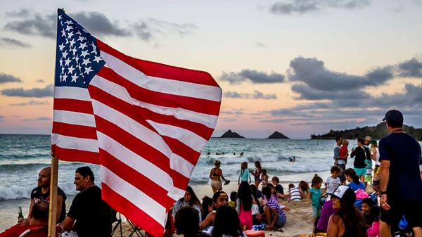 Crowds gather to watch the Fourth of July fireworks show last year at Kailua Beach on the Hawaiian island of Oahu.