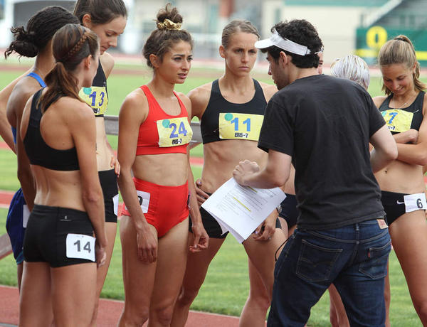 ''Tracktown'' star Alexi Pappas, center, speaks with director Jeremy Teicher during filming on location at historic Hayward Field in Eugene.