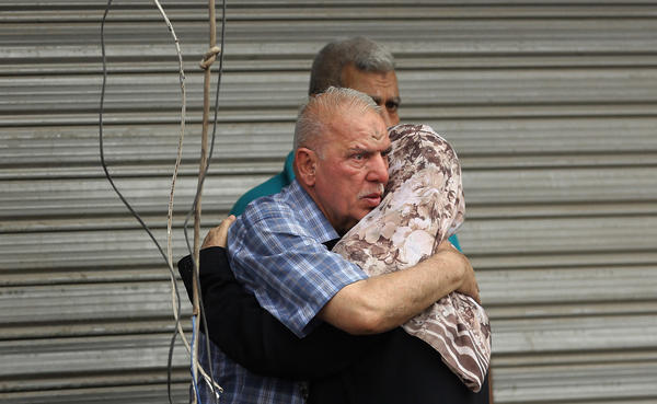 Iraqi family members whose relatives went missing after the bomb hit Karada.