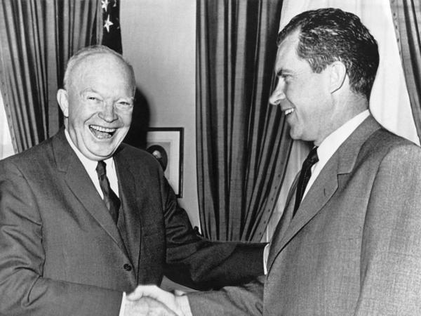 President Dwight D. Eisenhower (left) shakes hands with Vice President Richard Nixon after a conference at the White House on Oct. 3, 1960.