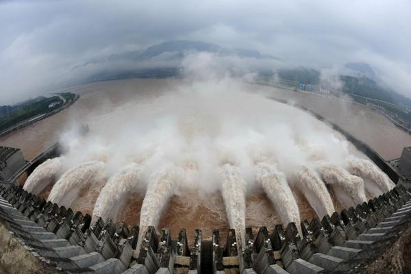 <p>Floodwater is released through the Three Gorges Dam in Yichang, China. Oregon State University created new software to assess the global potential for hydropower.</p>