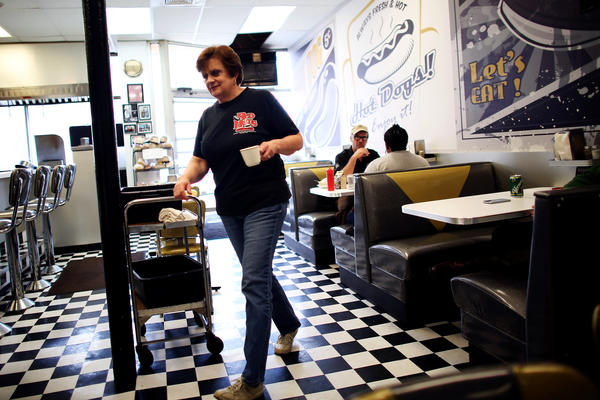 Carol Harlan is co-owner of Red Hots Coney Island and is married to Rich. She says that during the heyday of Detroit's auto industry, the restaurant was open 24 hours a day, often feeding workers at the local Ford plant.