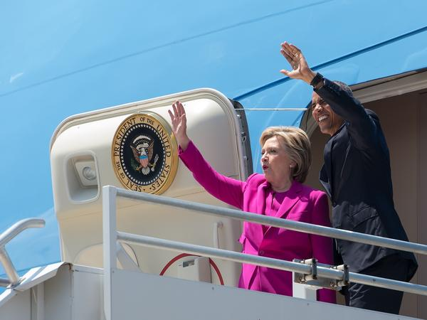 President Obama and Hillary Clinton walk off Air Force One in Charlotte, N.C., to attend a Clinton campaign event. The costs of that flight will be repaid by the Democratic National Committee.