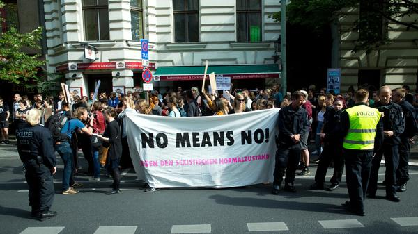 Demonstrators protest in Berlin on June 27, 10 days before Germany's parliament approved tougher anti-rape laws.