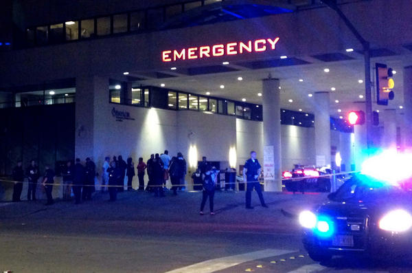 Police and others gather at the emergency entrance to Baylor Medical Center in Dallas, where several police officers were taken after the shootings on Thursday evening.