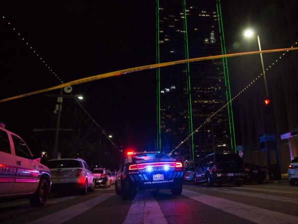 Police cars sit on Main Street in Dallas following the shooting during a protest on Thursday. Five law enforcement officers were killed in the course of the attack.