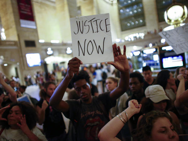 People take part in a protest in New York City's Grand Central Station on Friday.