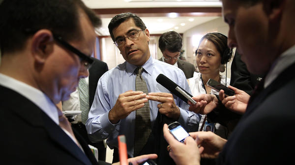 Rep. Xavier Becerra speaks to members of the media as he arrives at a closed briefing for members of the House of Representatives in 2013.