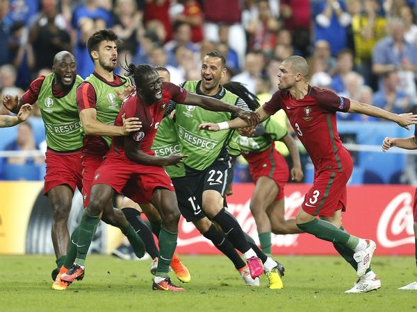 Portugal players celebrate after Eder (center) scored the winning goal during the Euro 2016 final soccer match between Portugal and France in Saint-Denis, north of Paris, on Sunday.