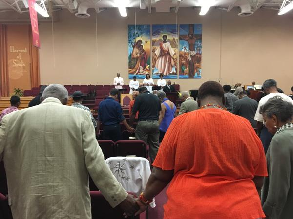 Worshippers bow their heads as the Rev. David A. Keaton leads them in prayer at the Fellowship Missionary Baptist Church in Minneapolis on Sunday.