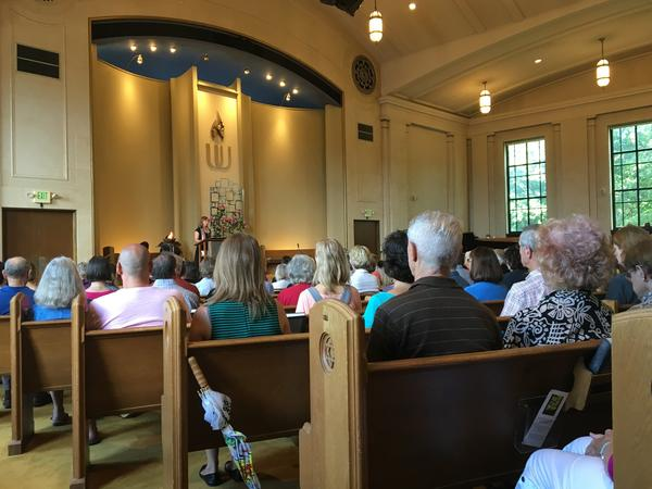 Congregants listen to the Rev. Elaine Aron Tenbrink deliver the sermon at the First Universalist Church of Minneapolis on Sunday.