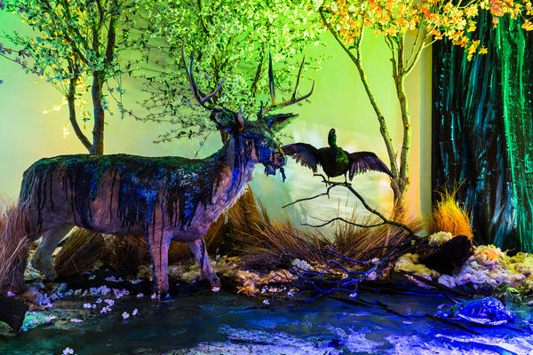 Diners were urged to contemplate what it means to consume. Near their dinner table, a sculpture depicts an oil spill — the taxidermied animals are depicted struggling in the muck.