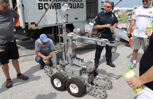 Police in Cleveland show off their bomb squad robot.