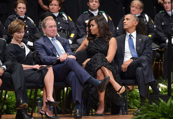 Former first lady Laura Bush, left, former President George W. Bush, first lady Michelle Obama and President Obama attend an interfaith memorial service for the police officers killed in Dallas.