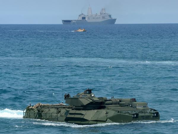 A U.S. Marine amphibious assault vehicle makes its way to shore after leaving an amphibious transport dock ship during a landing exercise on a beach at San Antonio in the Philippines' Zambales Province on April 21, 2015. The exercise was part of annual Philippine-U.S. joint maneuvers and took place some 137 miles east of the Scarborough Shoal in the South China Sea.