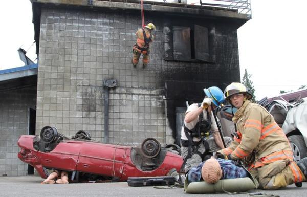 <p>First responders rescue dummies from crumpled cars during the Cascadia Rising earthquake simulation.</p>