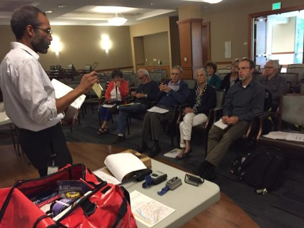 <p>Ernie Jones with Portland Bureau of Emergency Management trains volunteers to set up and operate neighborhood emergency tents.</p>