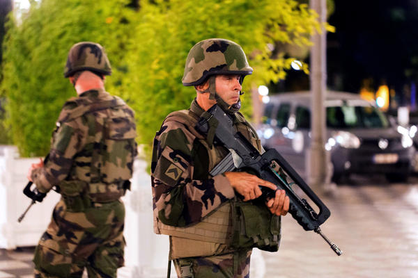 French soldiers stand guard by the sealed off area of the French resort city of Nice on Friday.