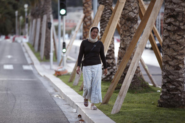 A woman cries, asking for her son, as she walks near the scene of Thursday evening's attack in Nice.