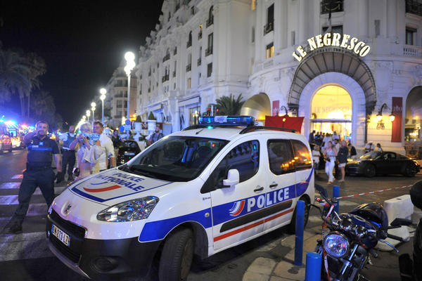 A police car is parked Friday near the scene where a truck plowed through a crowd of Bastille Day revelers who had gathered to watch fireworks Thursday night in the French resort city of Nice.