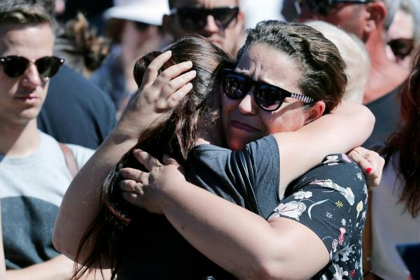 Women react near the scene of Thursday evening's attack in Nice, France.