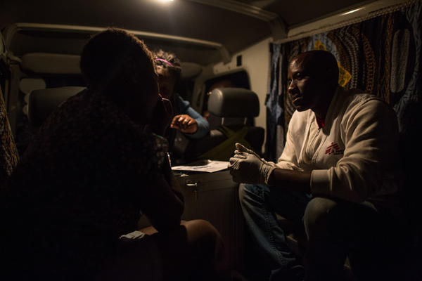 A peer educator who works for Doctors Without Borders (right) tests a sex worker for HIV, yellow fever and syphilis inside the health aid group's vehicle in Beira, Mozambique.