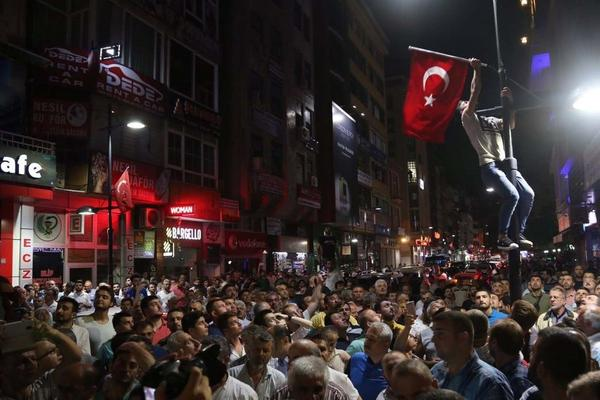 People react to the attempted military coup in Rize on Friday.