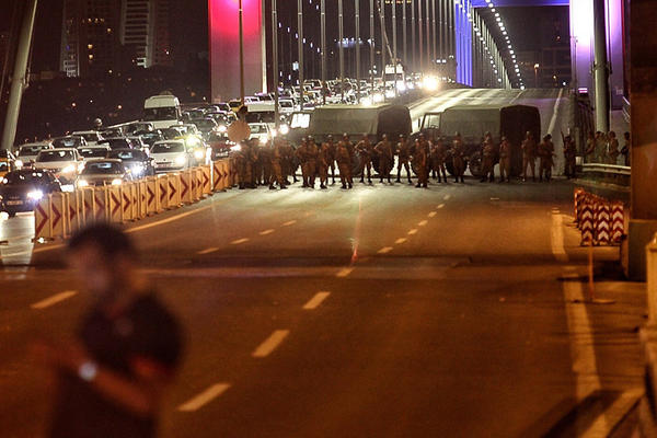 Turkish soldiers block Istanbul's Bosporus bridge on Friday while soldiers also occupied streets in the capital of Ankara.