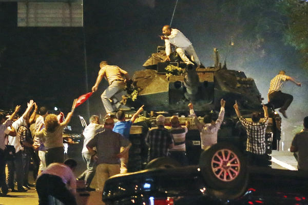 A tank moves into position as Turkish people attempt to stop it early Saturday in Ankara, Turkey.