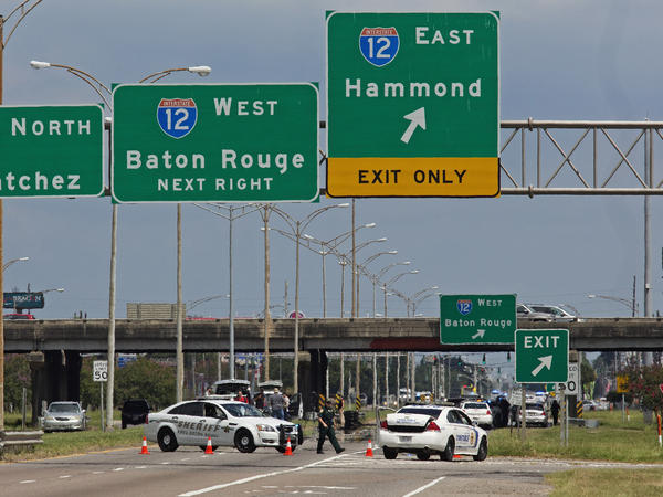 Baton Rouge police block Airline Highway after police were shot in Baton Rouge, La., on Sunday. Several law enforcement officers were killed and several injured in a shooting in Baton Rouge on Sunday morning.