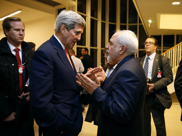 Secretary of State John Kerry talks with Iranian Foreign Minister Mohammad Javad Zarif in Vienna on Jan. 16, after the International Atomic Energy Agency verified that Iran met all conditions under the nuclear deal. The accord is now one-year-old. Iran is seen as abiding by the requirements of the deal, but its relations with the U.S. and other rivals have not improved on other fronts.