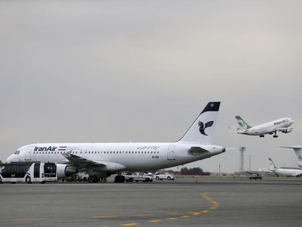 An Iran Air jet sits on the tarmac of Tehran's Mehrabad airport. Last month, Boeing announced it had signed a provisional agreement for the sale or lease of more than 100 aircraft to the national carrier over the next decade.